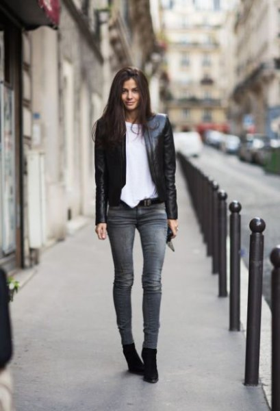 black leather jacket with white oversized t-shirt and gray skinny jeans