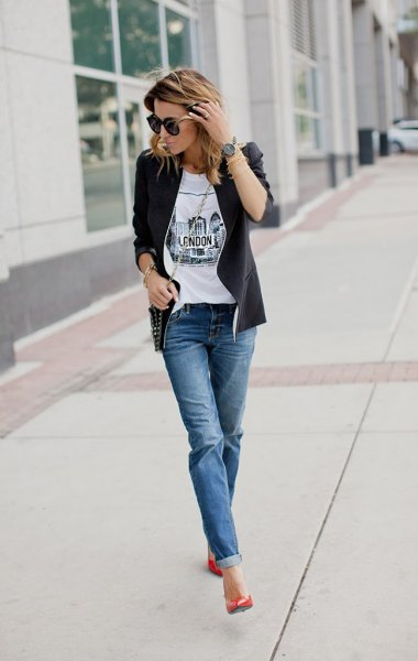 black leather jacket with white printed t-shirt and blue cuffed jeans