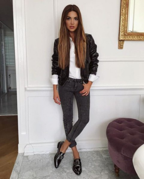 black leather jacket with white shirt and dark gray skinny jeans with cuffs