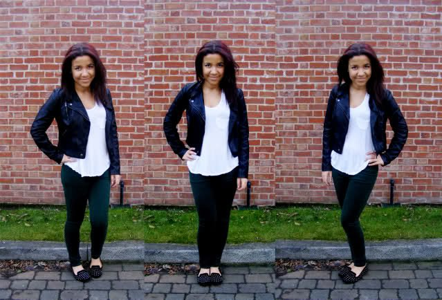 black leather jacket with white tank top and slim fit jeans