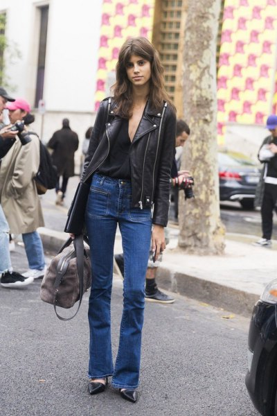 black leather moto jacket with blue flared jeans