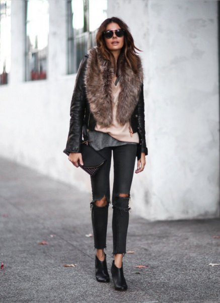 black leather moto jacket with faux fur collar and ripped jeans