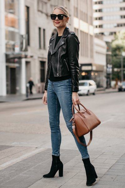 black leather moto jacket with gray-blue skinny jeans and boots with heels