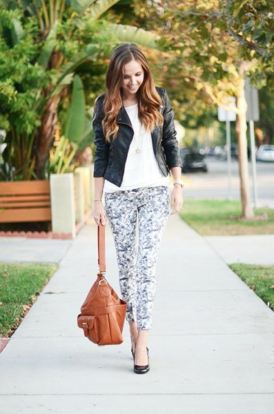 black leather jacket with white t-shirt and floral leggings