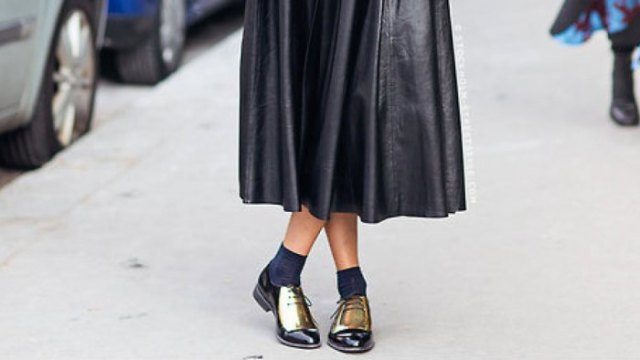black leather maxi dress with pleated fabric, gray crew socks and gold derby shoes