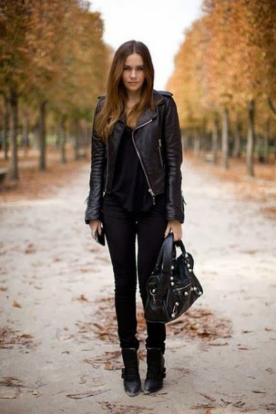 black leather riding jacket with scoop neckline and skinny jeans