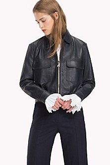 Sporty coat made of black leather with dark straight-leg jeans
