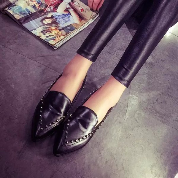 black leggings with matching wing tip shoes with rivets
