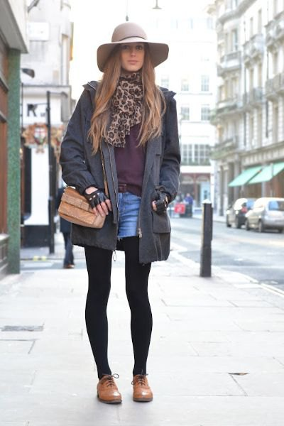 black long blazer with blue denim shorts and brown leather buck shoes