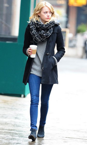 black long blazer with a ribbed sweater and dark blue suede boots