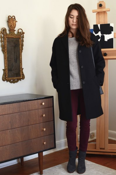 black long coat with gray sweater and dark skinny jeans