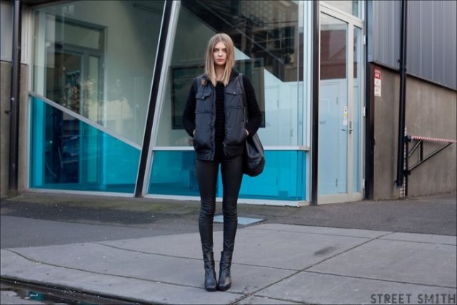 black long down vest with sweater and skinny jeans
