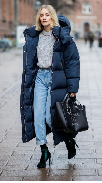 black long puffer coat with gray sweater and mom jeans