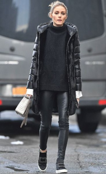 black long puffer coat with comfortable sweater with stand-up collar and leather gaiters