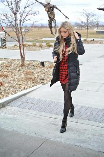 black long puffer coat with red and black checked mini dress