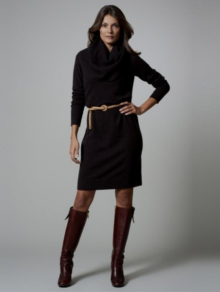 black long-sleeved dress with belt and knee-high leather boots