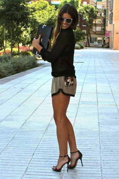 black long-sleeved blouse with gray silk mini-shorts