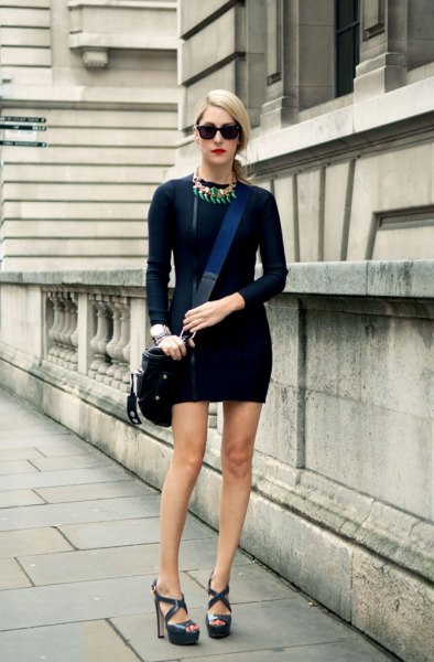 black bodycon mini bodycon dress with long sleeves and dark blue heeled sandals