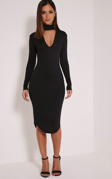 black long-sleeved collar with deep V-neck and figure-hugging dress