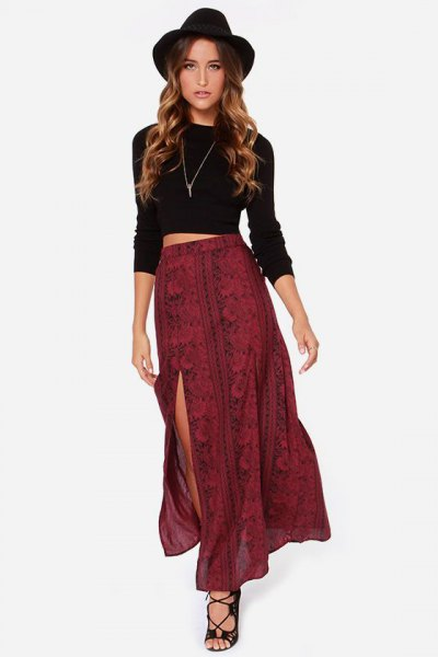 black long-sleeved crop top with red patterned double slit skirt