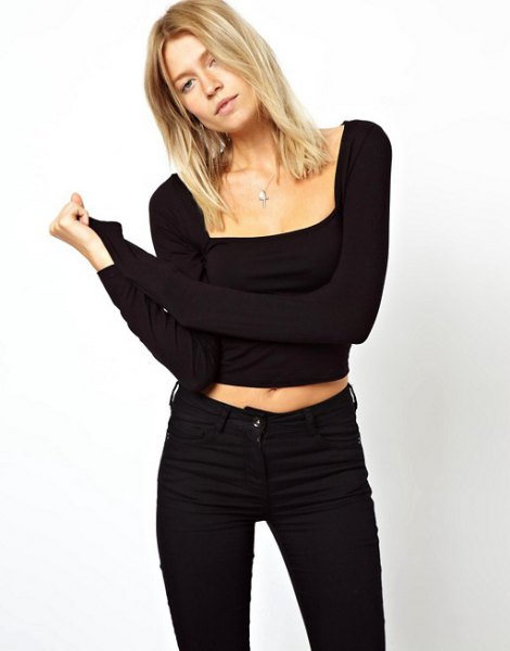 black, short-sleeved, cropped top with a square neckline and skinny jeans