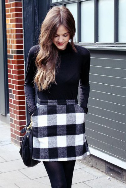 black long-sleeved t-shirt with gray and white checked wool miniskirt with pockets