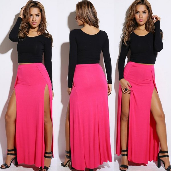 black, long-sleeved, figure-hugging sweater with pink maxi skirt with double slit