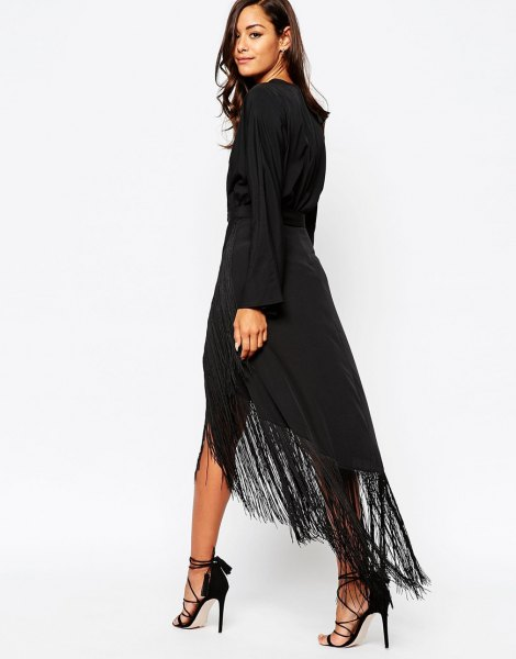 black long-sleeved maxi dress with high fringes