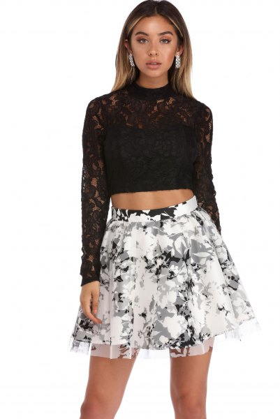 black long-sleeved skater skirt with a lace crop top and floral print