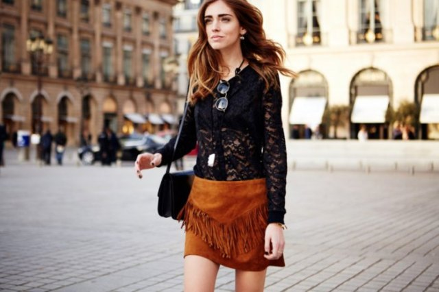black long-sleeved lace top with brown suede mini skirt with fringes