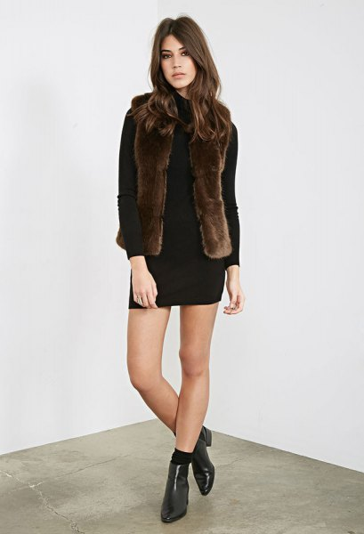 black long-sleeved mini dress with dark brown faux fur vest