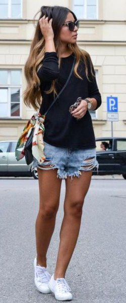 black long-sleeved sweater with light blue shorts