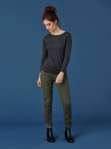 black long-sleeved t-shirt with gray slim fit jeans