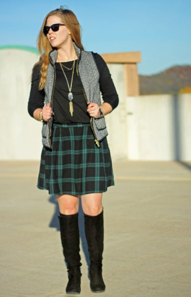 black long-sleeved T-shirt with green checked skirt and gray vest