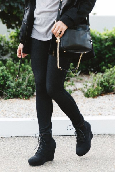 black long trench coat with leggings and wedge boots