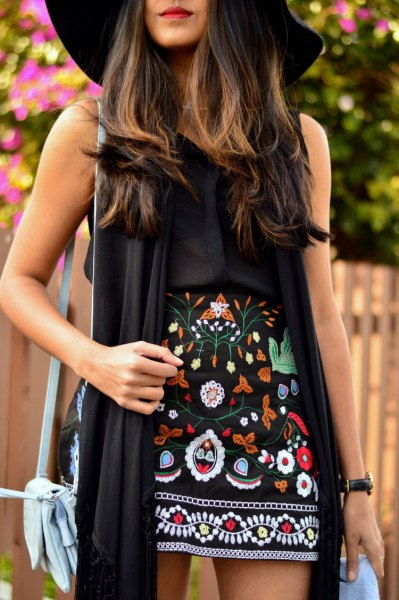 black floppy hat outfit with long vest