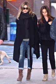 black long wool coat with jeans with cuffs and gray lace-up boots with laces