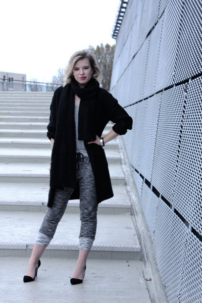black long wool coat with mottled, short-cut knitted trousers