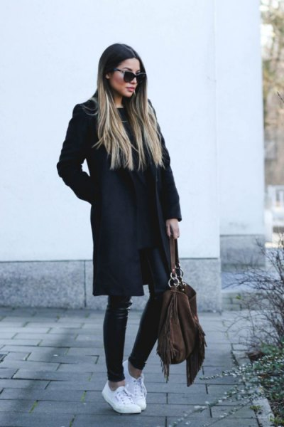 black long wool coat with leather gaiters