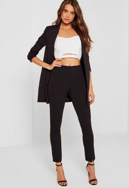 black longline blazer with a shortened white chiffon blouse and open toe heels