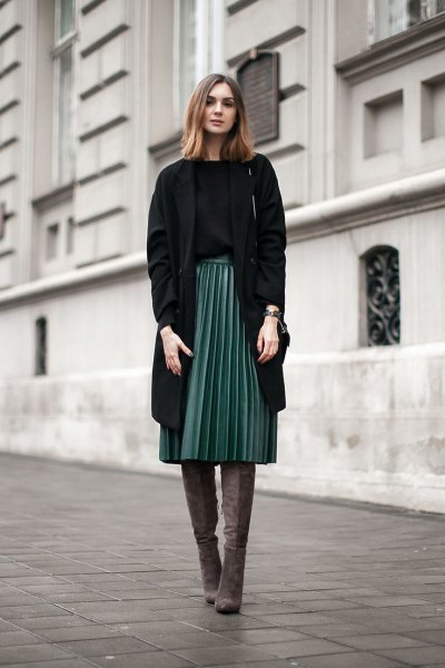 black longline blazer with gray pleated midi skirt and overknee boots