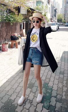 black longline cardigan with white printed t-shirt and blue denim shorts