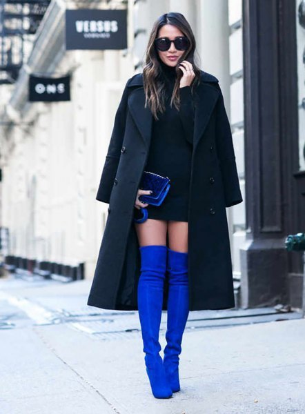 black longline coat with black mini dress and royal blue overknee suede boots