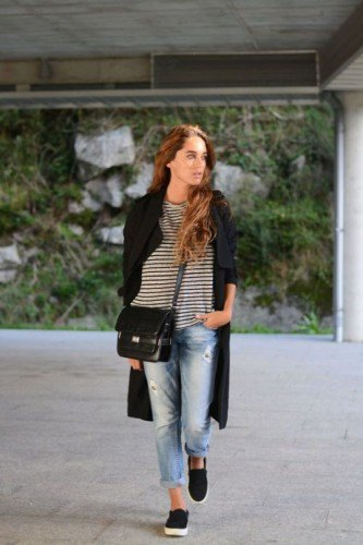 black longline coat with striped long-sleeved T-shirt and boyfriend jeans