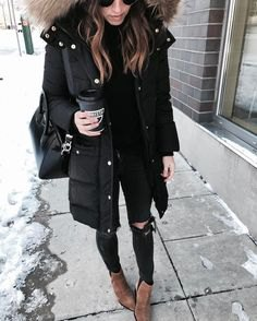 black longline down coat with light gray hood made of faux fur