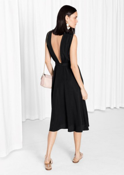 black linen flare dress with a low back