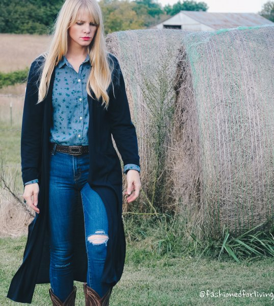 black maxi cardigan with purple shirt and blue jeans