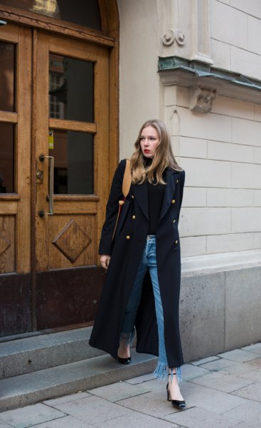black maxi coat with turtleneck and fringed jeans
