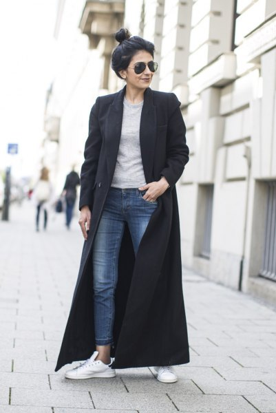 black maxi wool coat with gray sweatshirt and ankle jeans