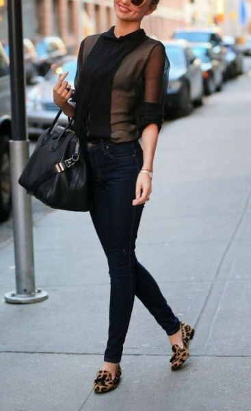 black fishnet blouse with high-rise jeans and tassel loafers